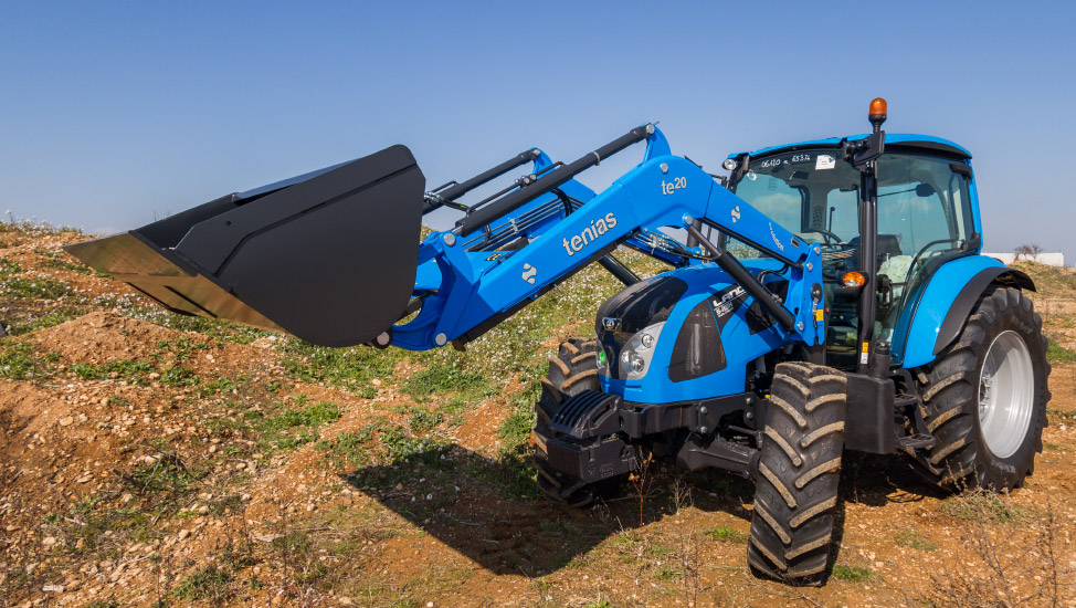 Blue evolution front loader mounted on a tractor