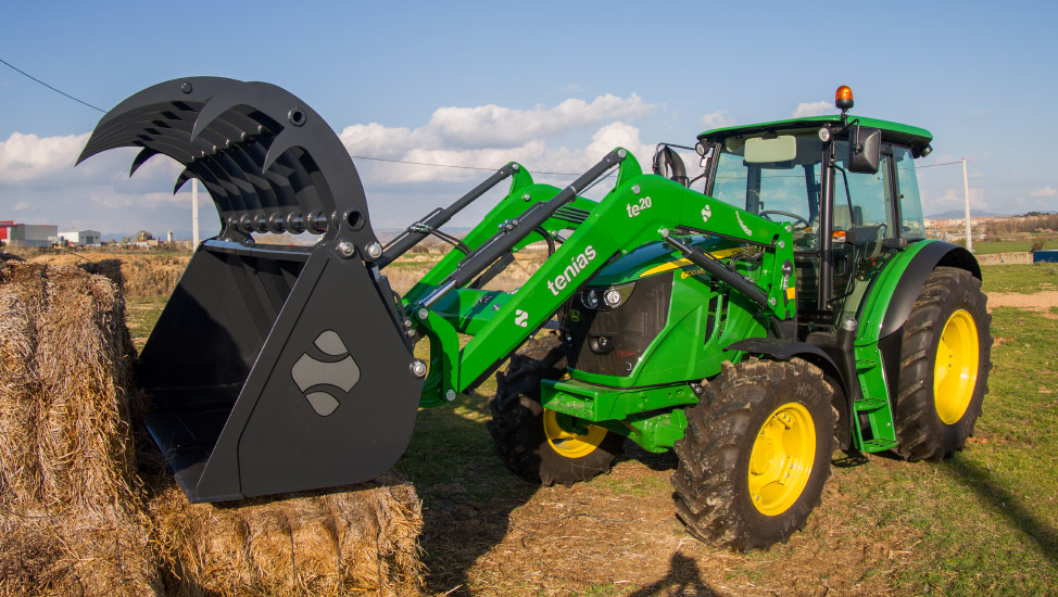 Green evolution front loader mounted on a tractor